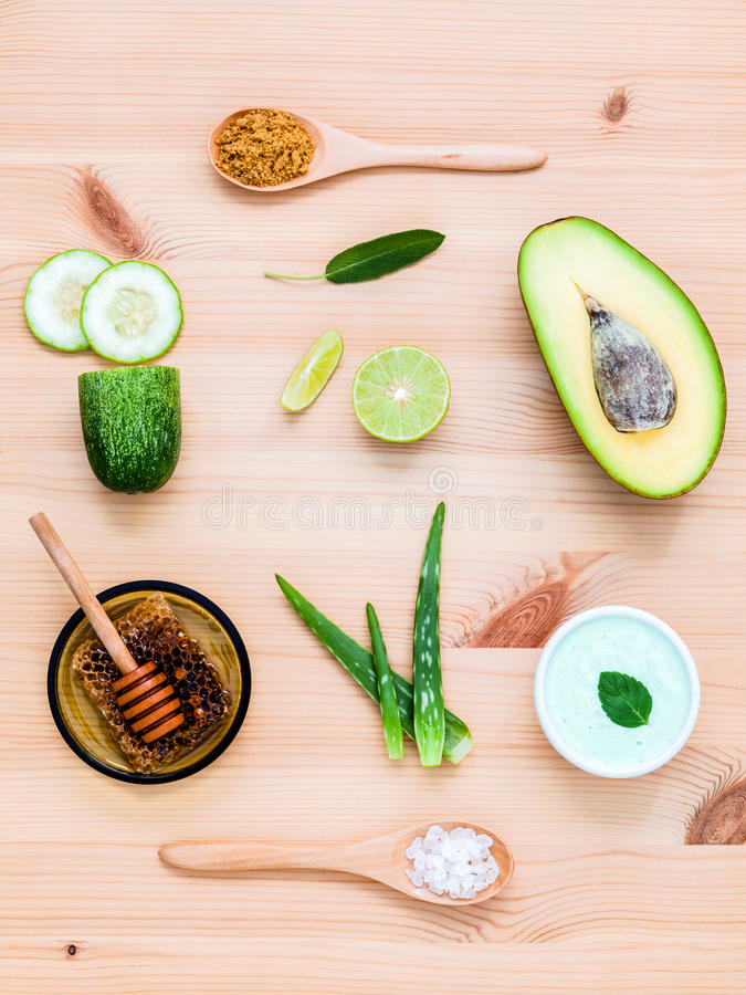 Homemade skin care and body scrub with natural ingredients avocado ,aloe vera ,lemon,cucumber and honey set up on wooden. Background stock image