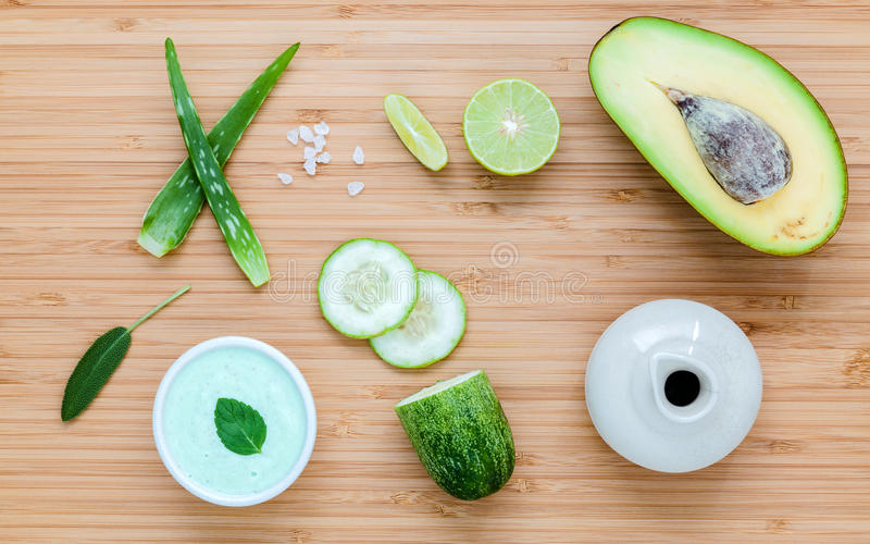 Homemade skin care and body scrub with natural ingredients avocado ,aloe vera ,lime,cucumber and honey set up on wooden. Background stock images