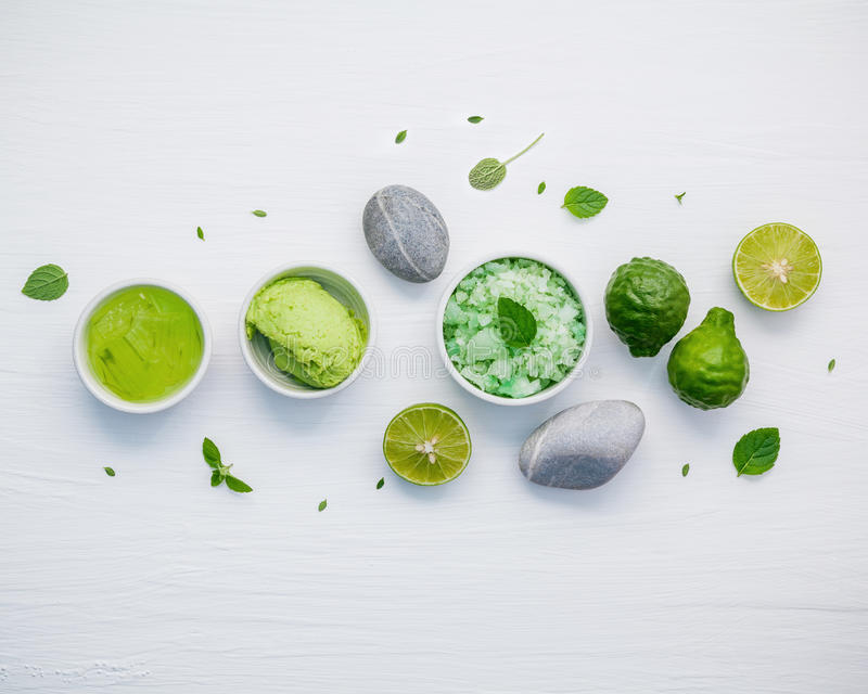 Homemade skin care and body scrubs with green natural ingredient. S aloe vera ,aromatic salt ,avocado scrub and spa stone set up on white shabby wooden royalty free stock photos