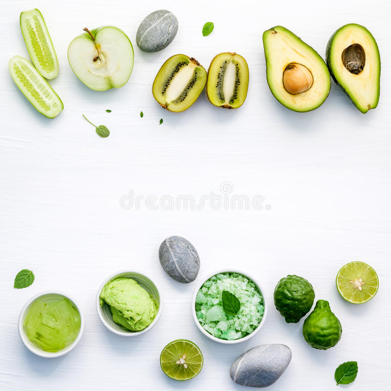 Homemade skin care and body scrubs with green natural ingredient. S aloe vera ,lime,cucumber ,aromatic salt ,green apple,mint ,rosemary ,kiwi and sage set up on royalty free stock image