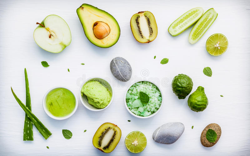 Homemade skin care and body scrubs with green natural ingredient. S aloe vera ,lime,cucumber ,aromatic salt ,green apple,mint ,rosemary ,kiwi and sage set up on stock images