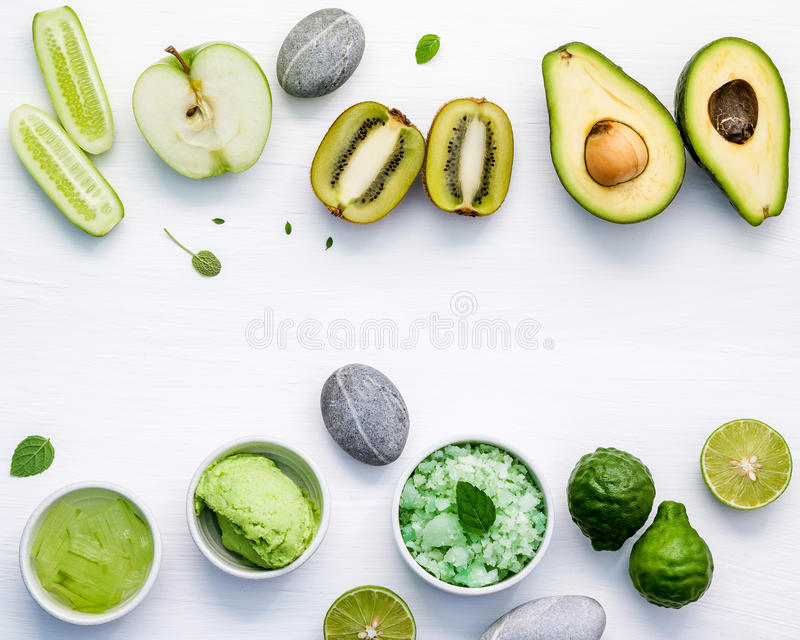 Homemade skin care and body scrubs with green natural ingredient. S aloe vera ,lime,cucumber ,aromatic salt ,green apple,mint ,rosemary ,kiwi and sage set up on royalty free stock images