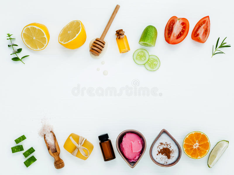 Homemade skin care and body scrubs with natural ingredients aloe. Vera ,lemon,cucumber ,himalayan salt ,tomato,mint ,lime slice,rosemary and honey set up on stock photos