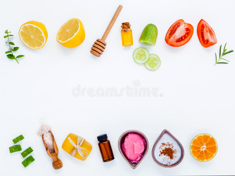 Homemade skin care and body scrubs with natural ingredients aloe. Vera ,lemon,cucumber ,himalayan salt ,tomato,mint ,lime slice,rosemary and honey set up on stock image