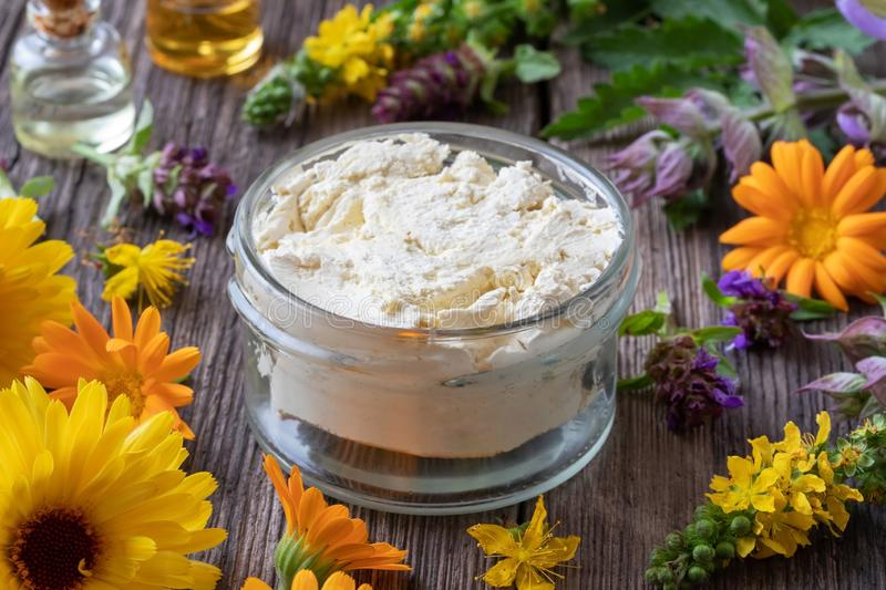 Homemade cream from herbs, essential oils and shea butter stock image