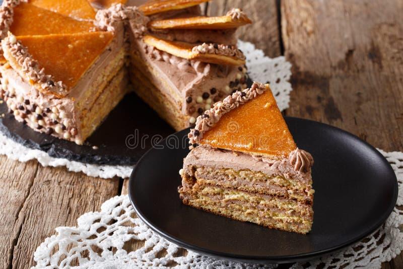 Homemade slice of Hungarian Dobosh cake with caramel close-up. h stock image