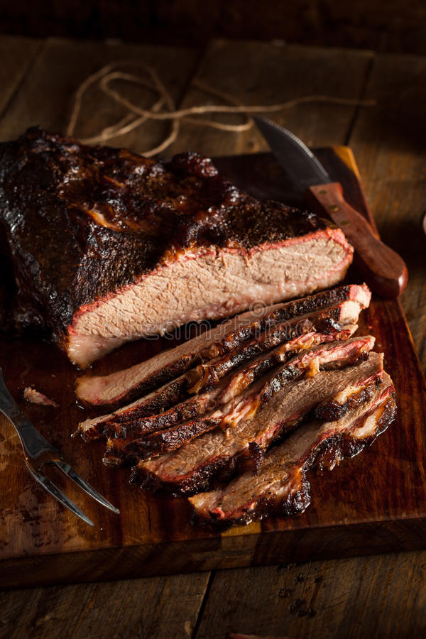 Homemade Smoked Barbecue Beef Brisket. With Sauce royalty free stock image
