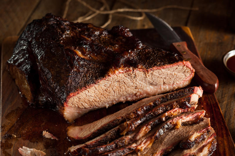 Homemade Smoked Barbecue Beef Brisket. With Sauce royalty free stock images