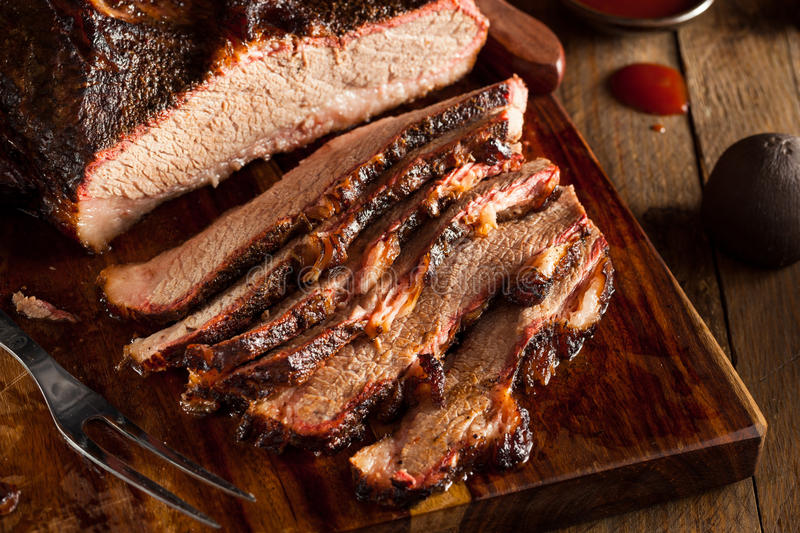 Homemade Smoked Barbecue Beef Brisket. With Sauce stock photo