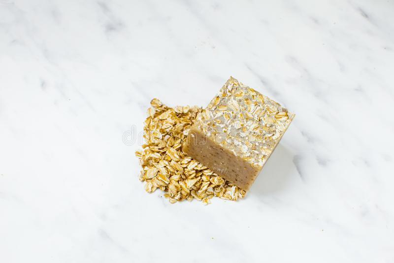 Homemade soap bar with oat grains, natural cosmetics royalty free stock image