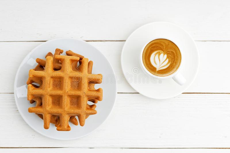 Homemade soft belgian waffles and cup of coffee royalty free stock photos