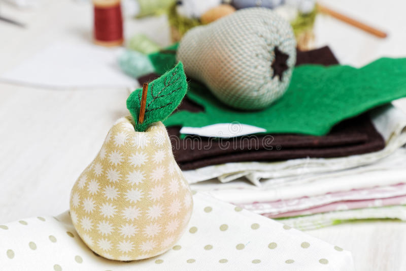 Homemade soft toy - pear from cloth. stock photos