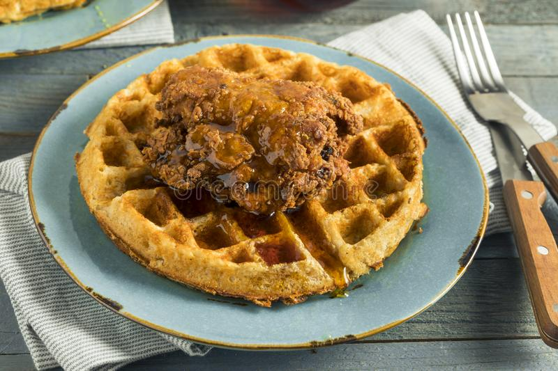 Homemade Southern Chicken and Waffles. With Syrup royalty free stock photo