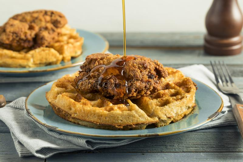 Homemade Southern Chicken and Waffles. With Syrup stock image