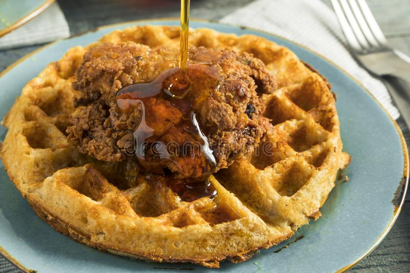 Homemade Southern Chicken and Waffles. With Syrup royalty free stock image