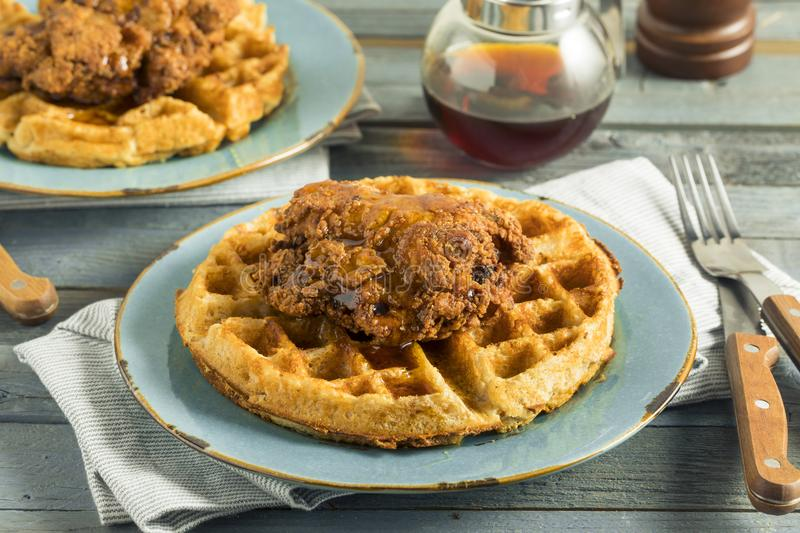 Homemade Southern Chicken and Waffles. With Syrup royalty free stock photos