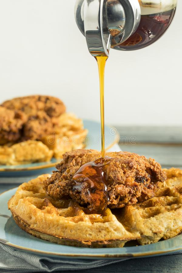 Homemade Southern Chicken and Waffles. With Syrup royalty free stock photography