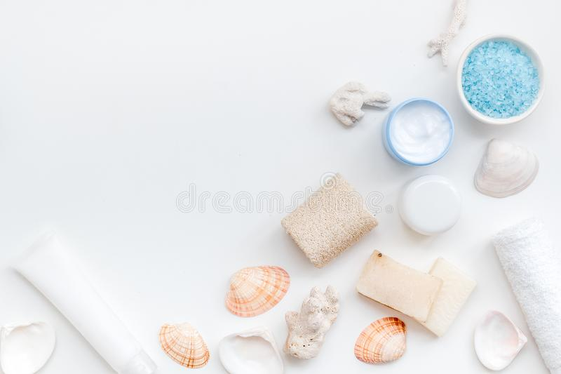 Organic cosmetic set with Dead Sea salt, cream and lotion on white background top view mock up stock photo
