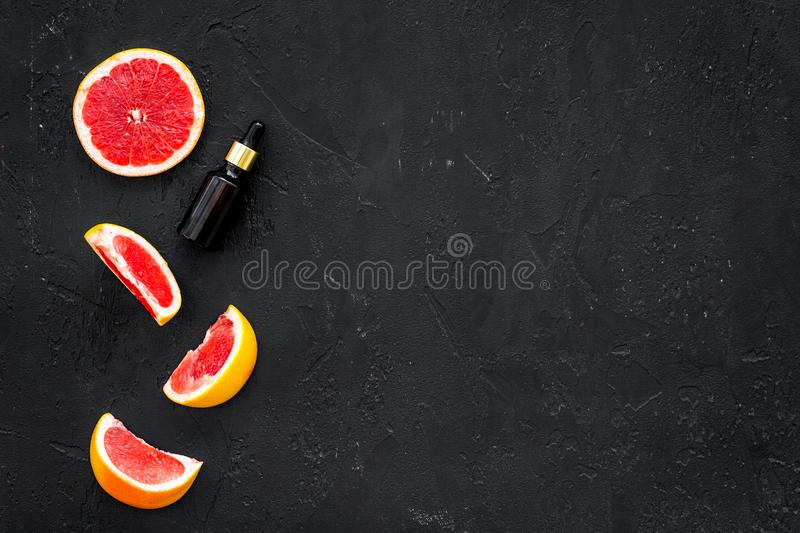 Homemade spa with grapefruit oil in natural cosmetic set fruit dark background top view mock up royalty free stock image