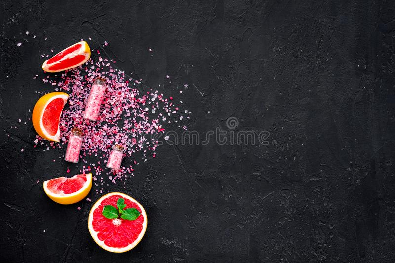 Homemade spa with grapefruit salt in natural cosmetic set fruit dark background top view mock up stock images