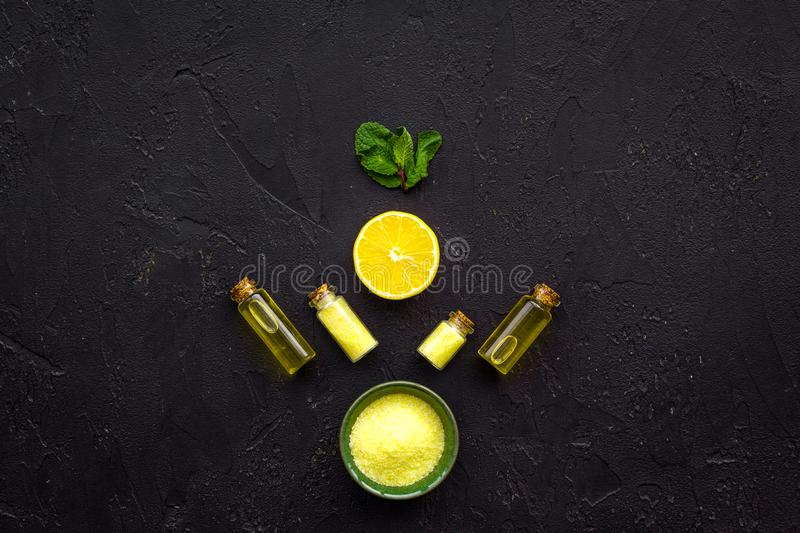 Homemade spa with lemon oil in natural cosmetic set on black background top view space for text royalty free stock photo