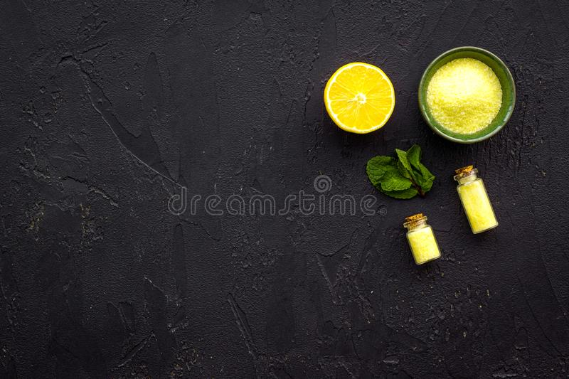 Homemade spa with lemon oil in natural cosmetic set on black background top view space for text stock images