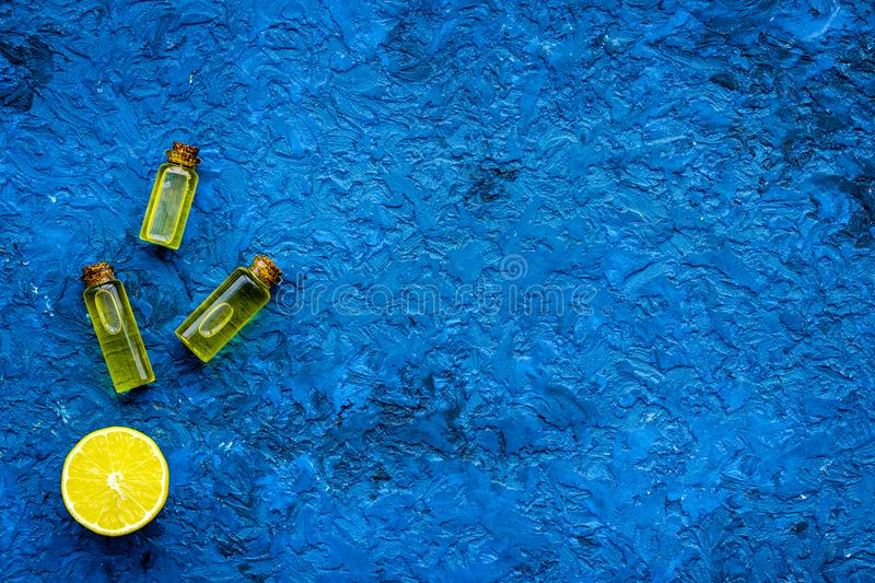 Homemade spa with lemon oil in natural cosmetic set on blue background top view space for text royalty free stock photography
