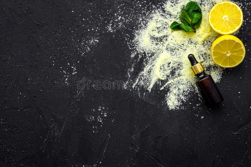 Homemade spa with lemon salt in natural cosmetic set on black background top view space for text royalty free stock images