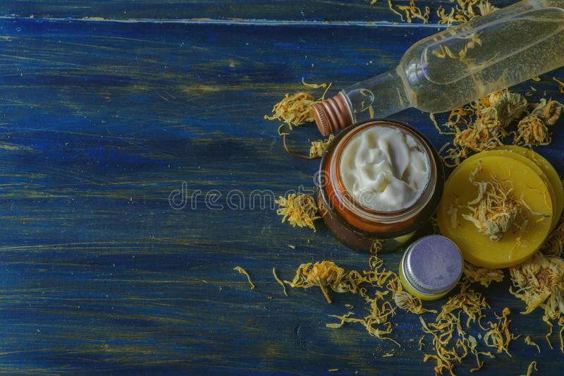 Homemade spa with natural ingredients of calendula and beeswax royalty free stock images