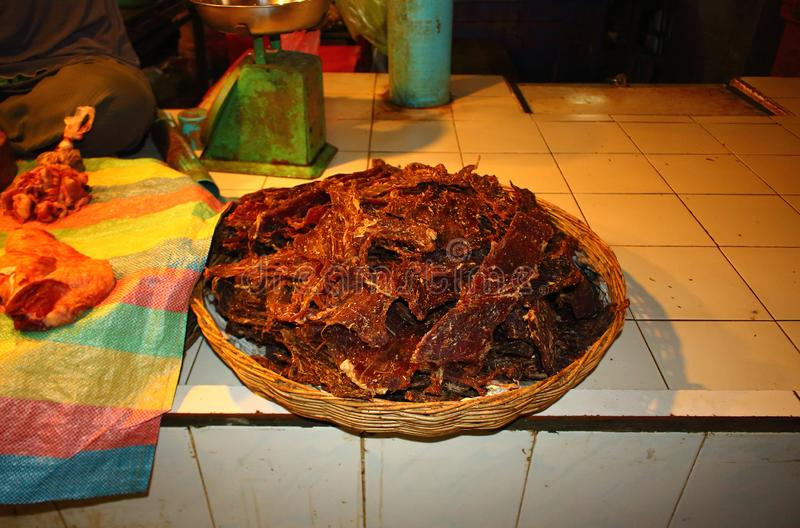 Homemade spiced jerky on asian market stock images