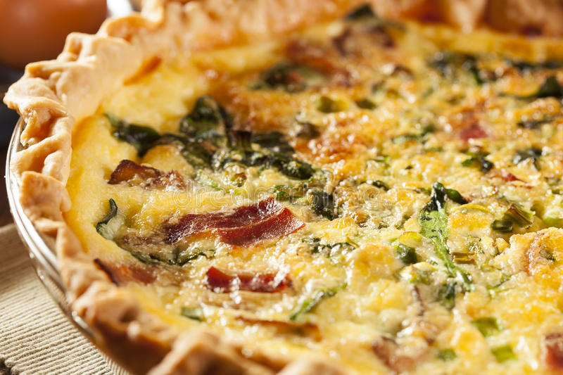 Homemade Spinach and Bacon Egg Quiche royalty free stock image