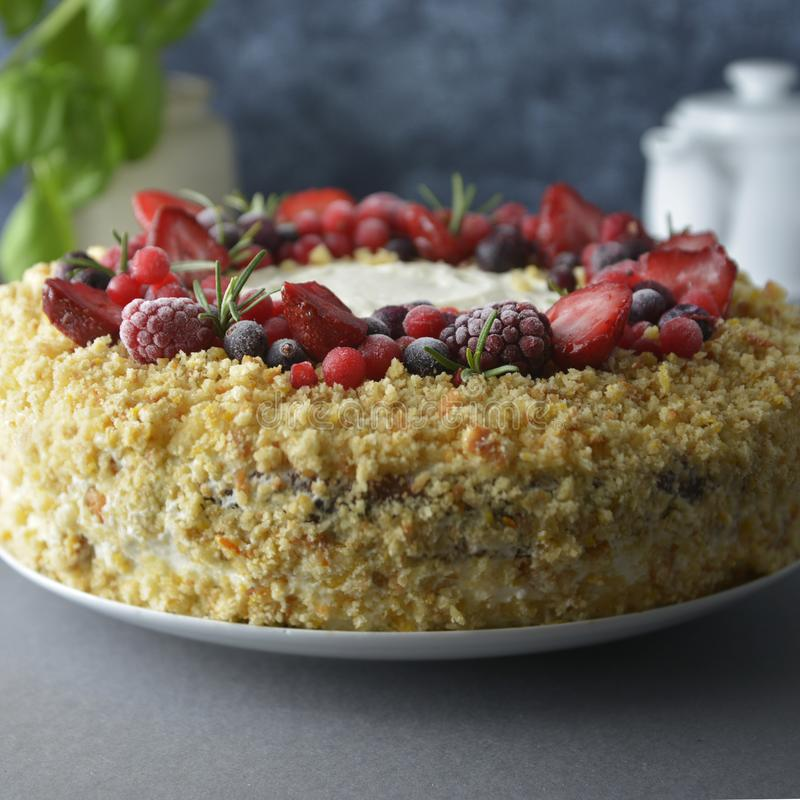 Homemade sponge cake with cream and fresh berries. Carrot and orange cake, decorated with berry. sweet dessert. Whole deliciouse royalty free stock photo