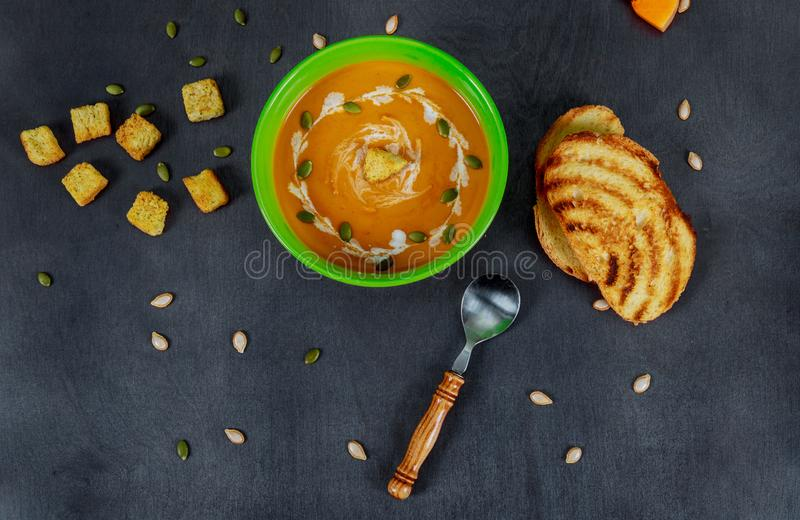 Homemade squash pumpkin soup with bread stock images