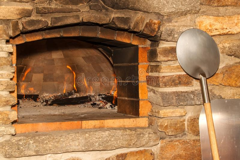 Homemade stone pizza oven. Traditional stone italian oven. Pizza production. Preparing for pizza party stock images