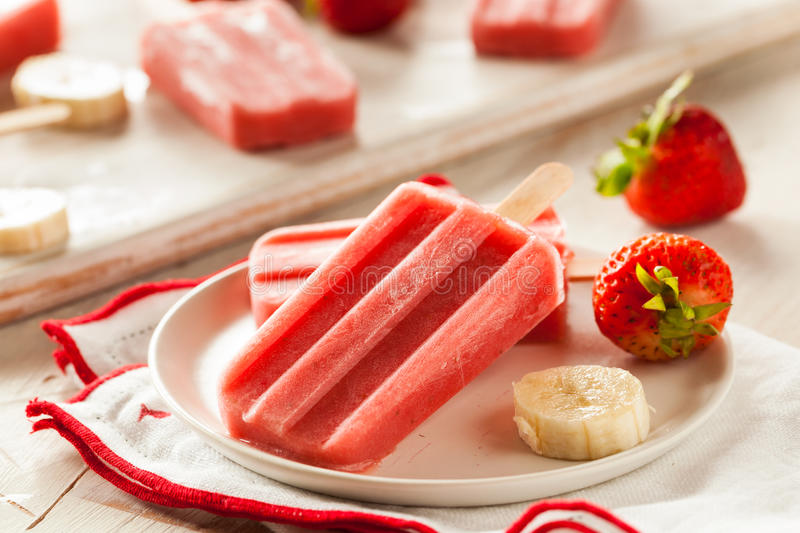 Homemade Strawberry and Banana Popsicles stock photos