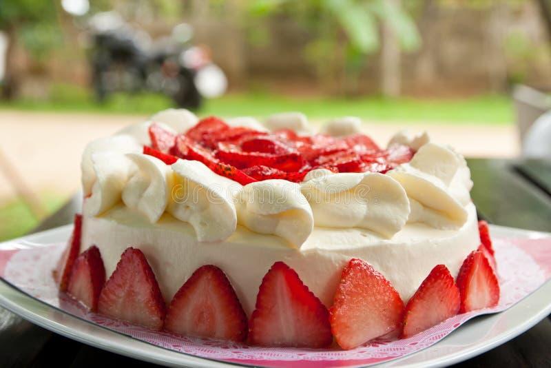 Homemade strawberry cake with cream stock photography