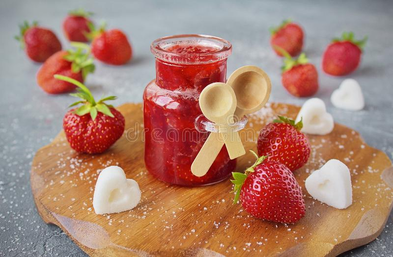 Homemade strawberry jam or marmalade in the glass jar stock images