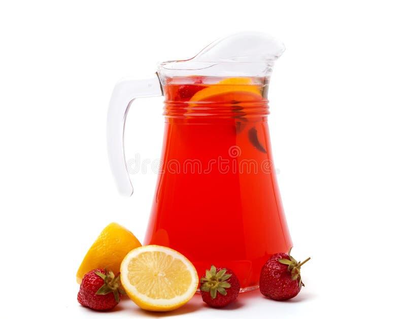 Homemade strawberry lemonade. Fresh homemade strawberry lemonade in a jug isolated on white background royalty free stock photography