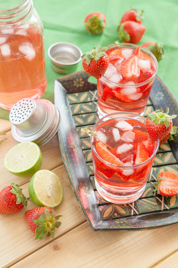 Homemade strawberry lemonade. Or sangria with fresh lime stock images