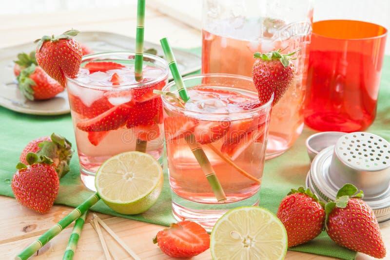 Homemade strawberry lemonade. Or sangria with fresh lime stock photography