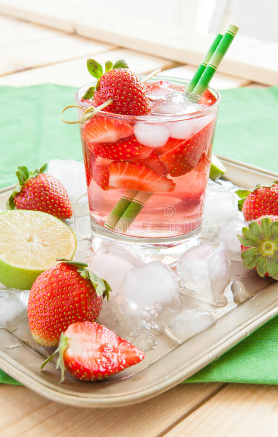 Homemade strawberry lemonade. Or sangria with fresh lime stock photos