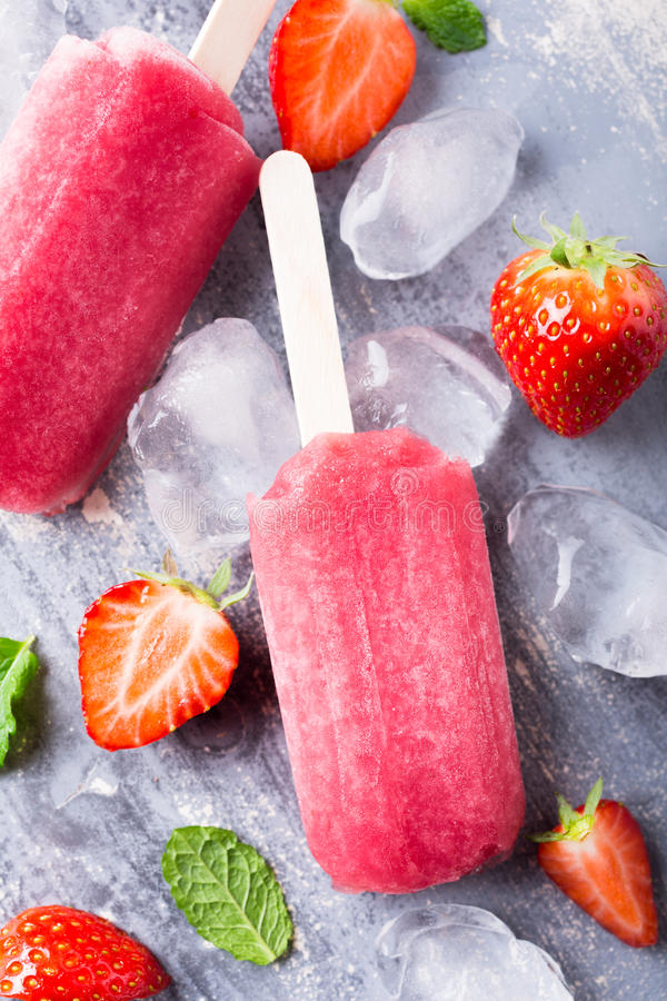 Homemade strawberry popsicles. With ice and berries. Summer food concept. Top view royalty free stock photography