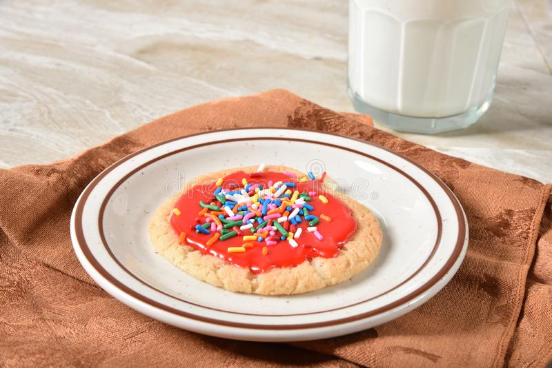 Homemade sugar cookie with candy sprinkles royalty free stock image