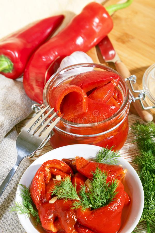Homemade summer crop preservation, vegetable vegetarian diet wholesome food, natural red bell fried pepper with garlic marinated stock photography