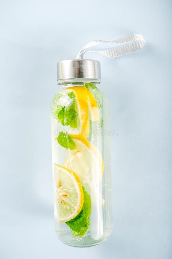 Homemade summer lemonade in bottle stock photos