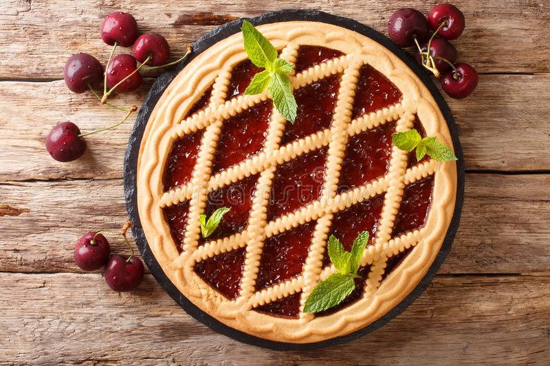 Homemade summer pastries cherry pie Crostata close-up. horizontal top view stock photos