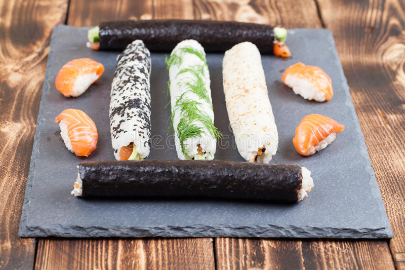 Download Homemade sushi rolls stock image. Image of seed, plate - 71217069