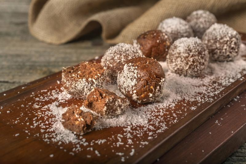Homemade chocolate balls with coconut stock images