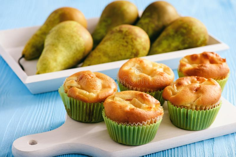 Homemade sweet muffins with pear stuffing. stock photo
