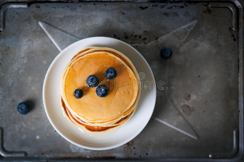 Homemade sweet pancakes with blueberries, fruit jam and honey stock photo